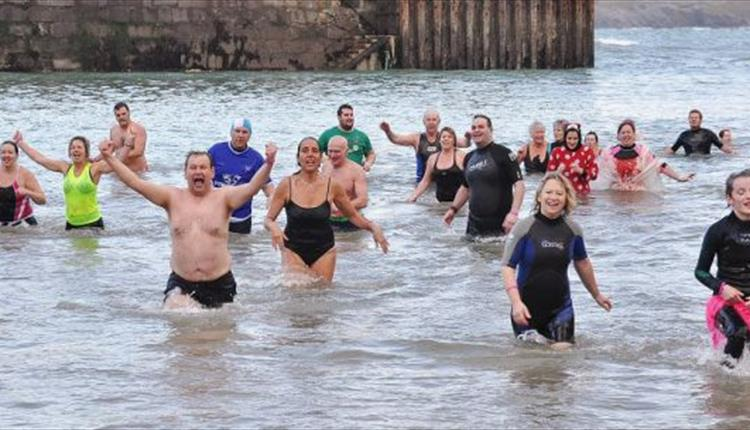 New Year's Day 'Dip for Clic' at Newquay Harbour